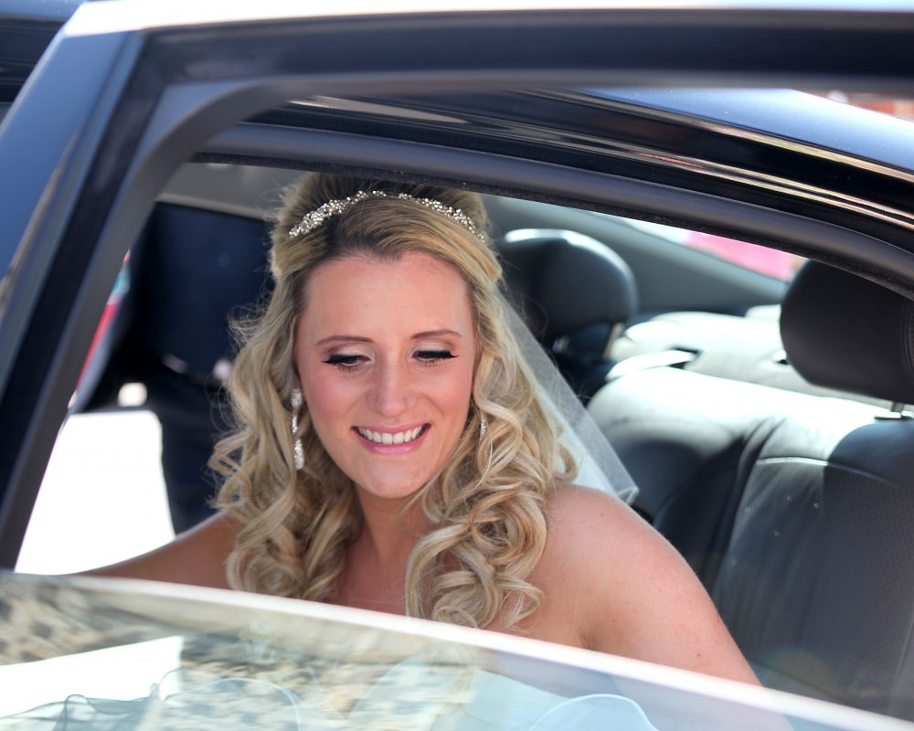 Bride getting out of luxury car - wedding photographer hertfordshire
