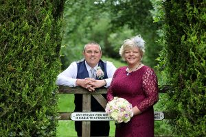 bride and groom by field gate - wedding photographer in bedfordshire