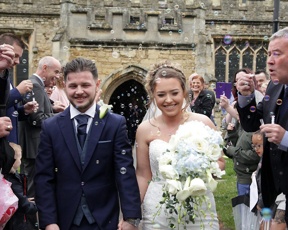 Newly weds walking out of church - wedding photographer bedfordshire